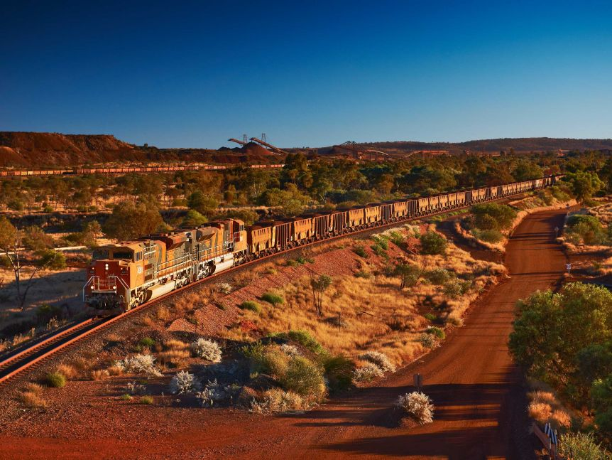 An iron freight train on the line from BHP's Mt Newman mine in the Pilbara, WA.
