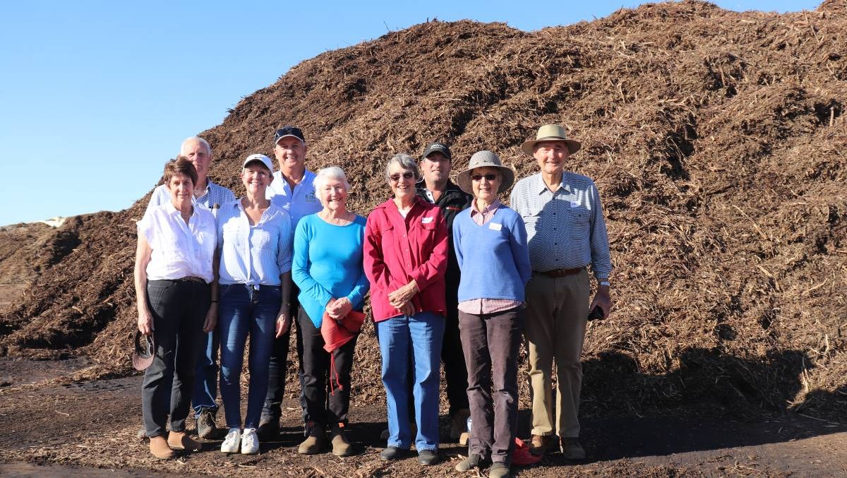 Representatives of five of the original six Kalannie families which founded Kalannie Distillers that later became Kochii Australian Eucalyptus Oil in front of the mountain of biomass that the company plans to use to generate electricity and produce biochar and wood vinegar. Pictured are Helen and Rob Millsteed (left), Robyn and Ian Stanley, Elva Rolinson, Angela and Mark Waters and Helen and Robert Nixon.